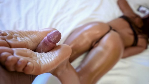 Cute Brunette Gives Oily Footjob [HD]