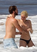 Miley Cyrus Goes Topless at the Beach in Hawaii